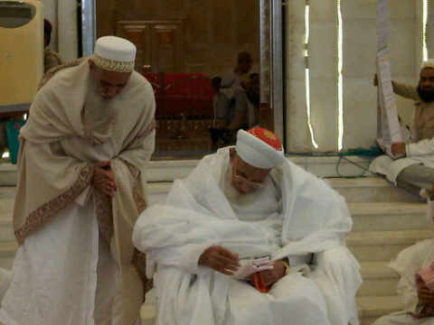 Syedna Mohammed Burhanuddin RA with his Mansoos, Syedna Mufaddal Saifuddin TUS during Nass ceremony at Raudat Tahera