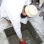 Janab Amil Saheb laying the tasees in the foundation by Raza of Aqa Maula TUS